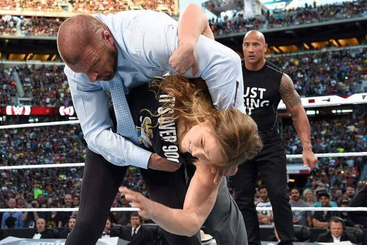 Ronda takes out Triple H!