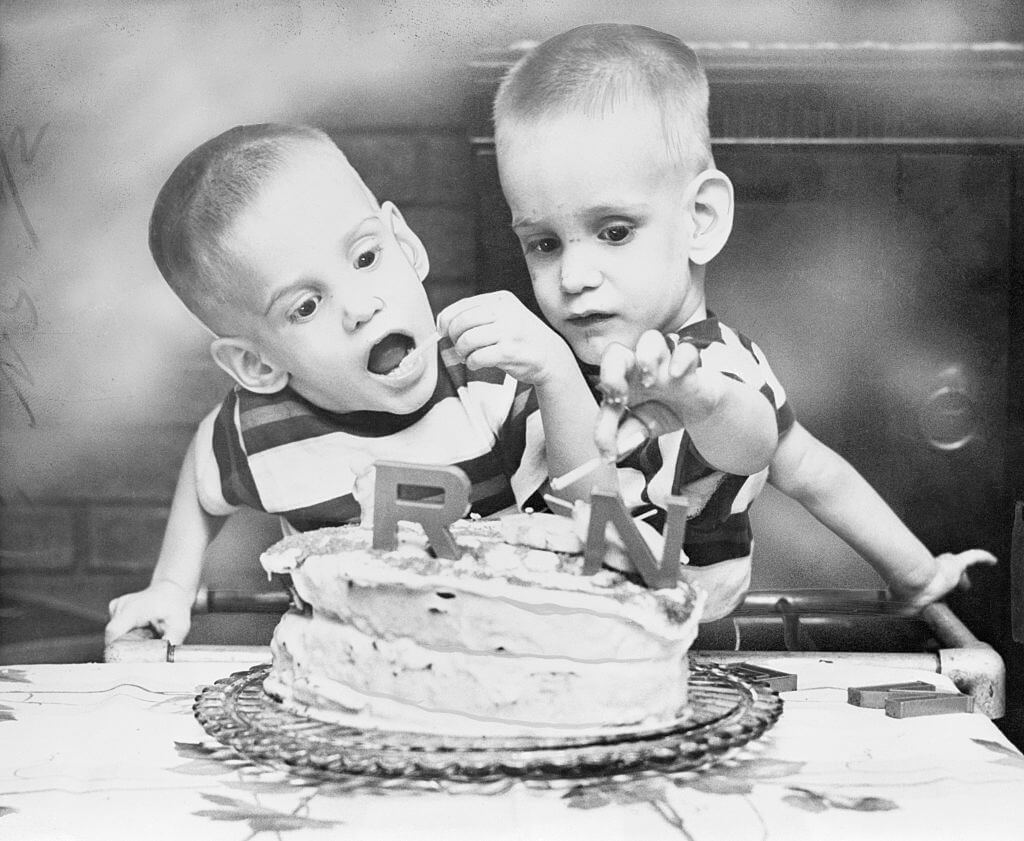 Siamese Twins Eating Cake