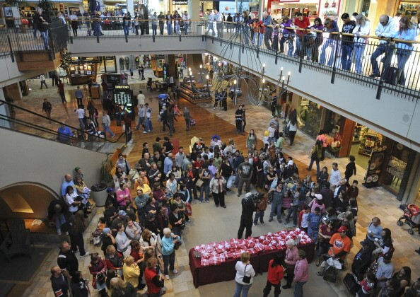 MALLS27-- Randomly selected shoppers at FlatIron Crossing get a chance to unwrap a hidden $500 FlatIron Crossing American Express Gift Card on Black Friday in Broomfield. The mall was packed with holiday shoppers looking for Black Friday deals. RJ Sangost