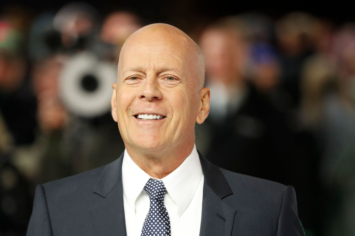 bruce willis smiling in a suit