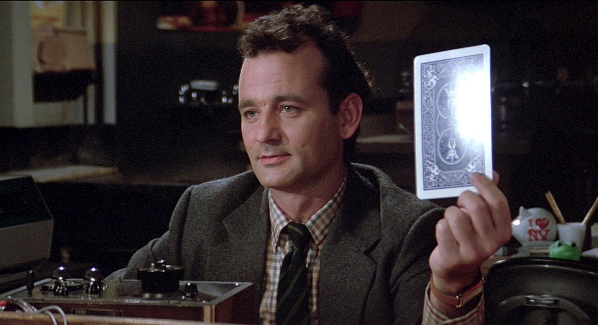 Bill Murray holds up card in Ghostbusters.