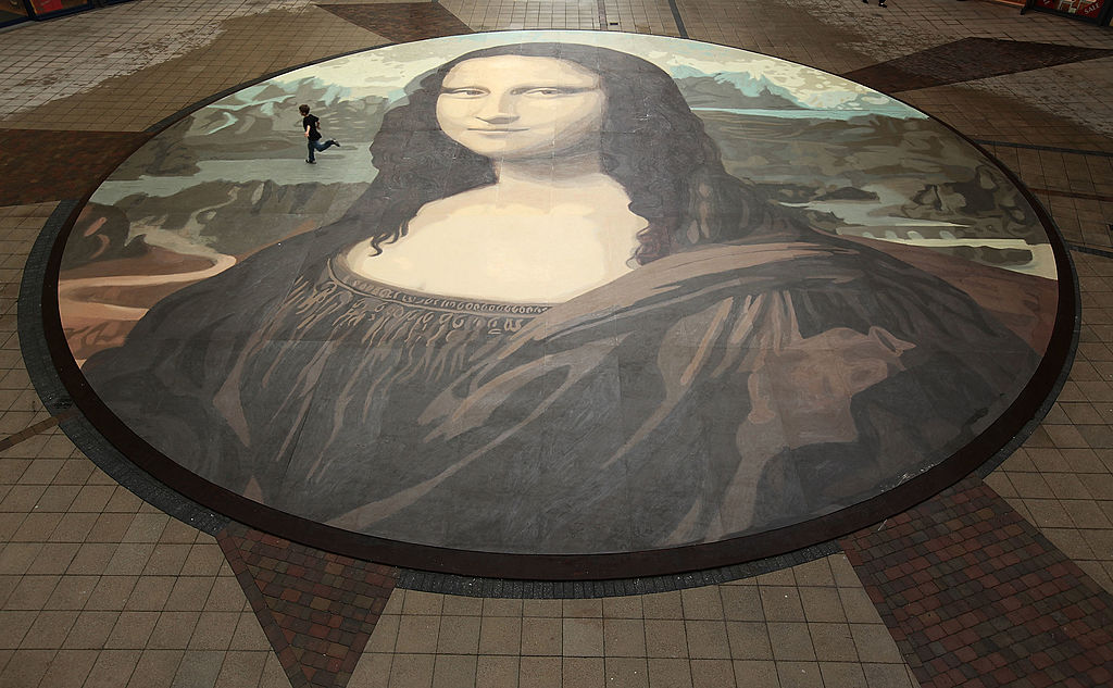 Luke Wharton-Jones, aged eight, runs across the world's biggest copy of the Mona Lisa during a photocall for its unveiling on October 28, 2009 in Wrexham, Wales