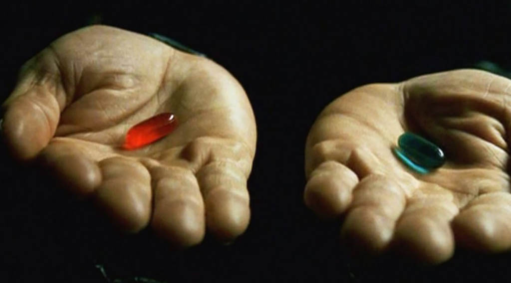 hands holding a red pill and a blue pill
