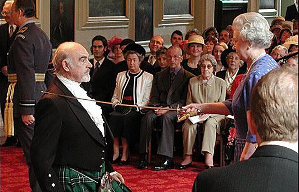 Connery being knighted by Queen Elizabeth
