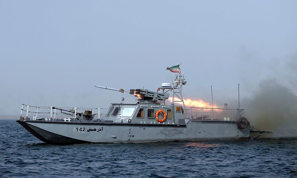 An Iranian war-boat fires a missile during the