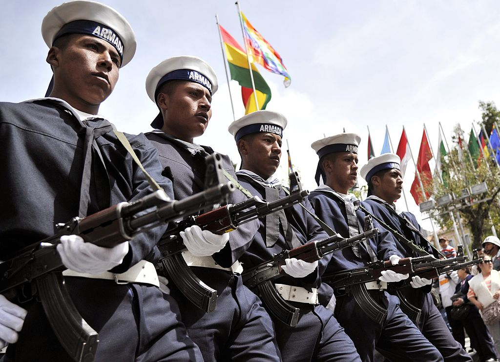 Bolivia navy troops parade during a ceremony commemorating the 134th anniversary of the invasion by Chilean troops