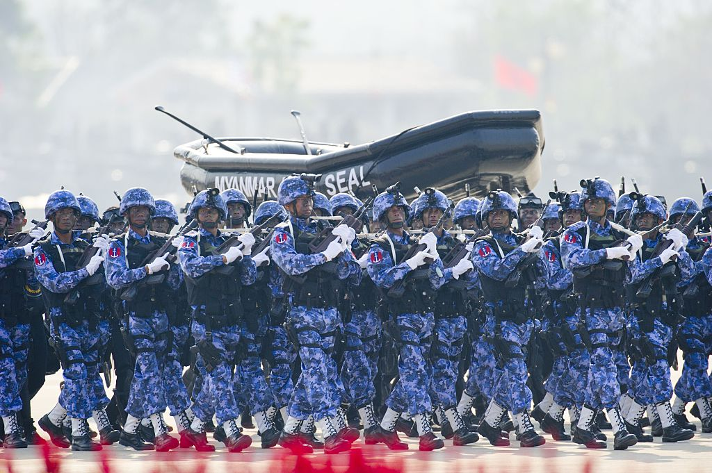 Myanmar Navy Seals march during a ceremony to mark the 70th anniversary of Armed Forces Day