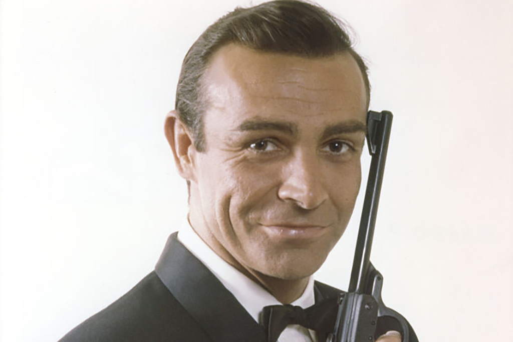 Sean Connery holding a gun as James Bond
