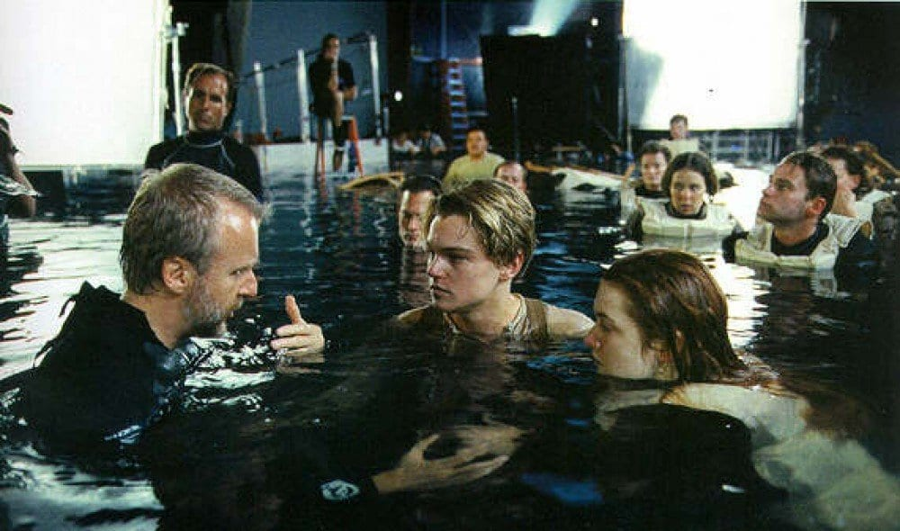 James Cameron talking to the actors in the water
