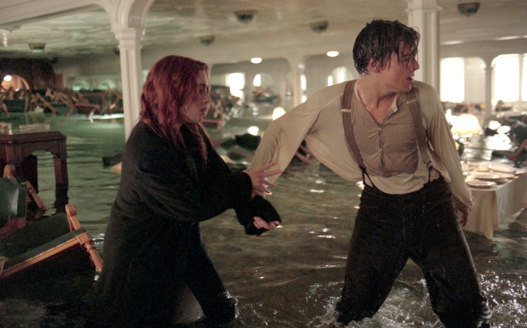 Rose and Jack wade through flooding ship in a scene from Titanic