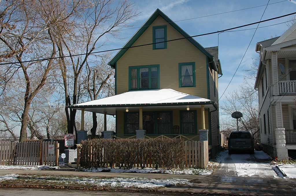 exterior of the yellow and green house from a christmas story