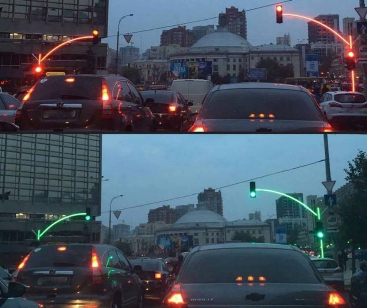 traffic lights with glowing poles that illuminate with the lights