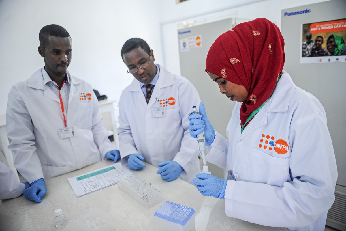 laboratory technicians demonstrating DNA testing at the Puntland Forensic Center in Somalia