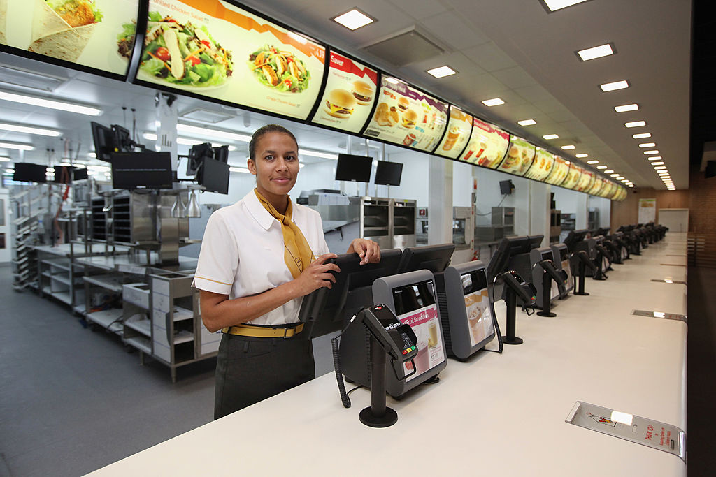 manager Rachel Lucien stands at the checkouts in the world's largest McDonald's restaurant