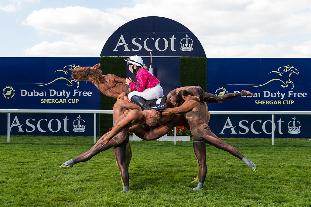 GettyImages-452963820 A team of ten acrobats form the shape of a racehorse crossing the winning post ridden by Stefanie Hofer to celebrate the upcoming Dubai Duty Free Shergar Cup at Ascot Racecourse on July 29, 2014 in Ascot, England. The Dubai Duty Free Shergar Cup is the only team-format raceday in the UK and takes place on 9th August.