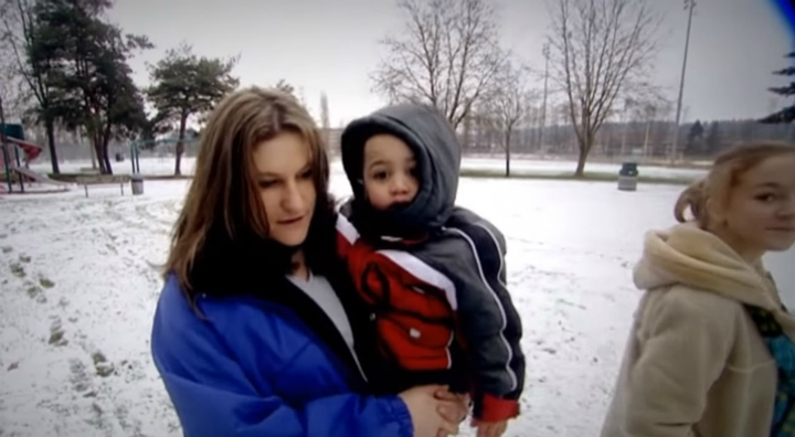 Lydia with one of her kids walking into court