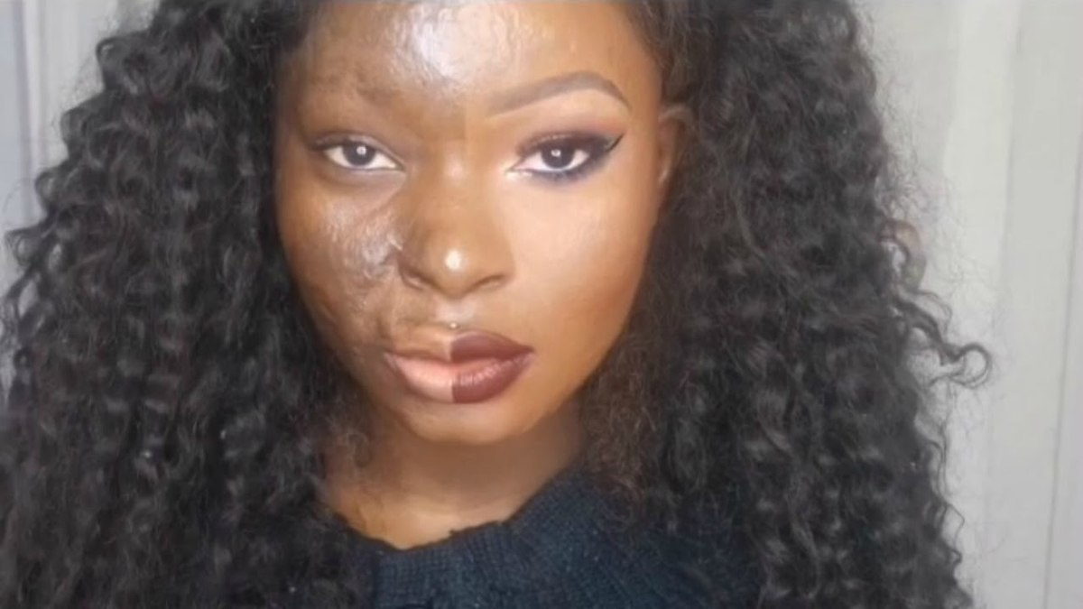 Shalom Blac putting make up on half of her face