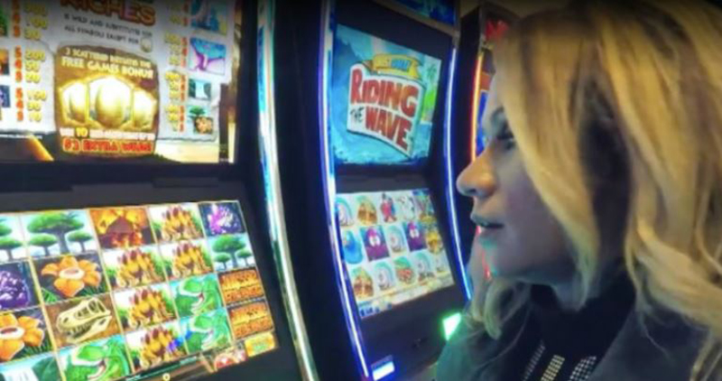 Veronica in front of a slot machine on KOIN 6 News