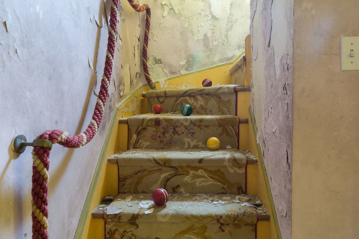 circus house balls on stairs abandoned house story