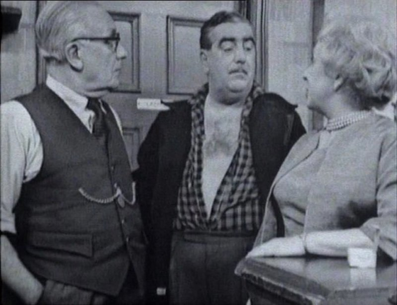 coronation street scene black and white three characters