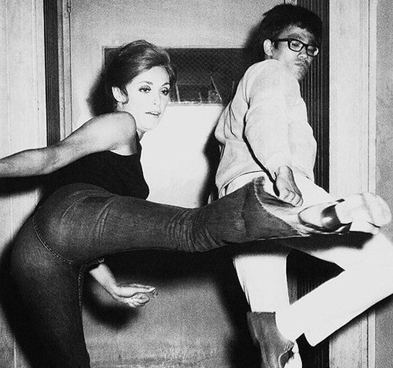 Sharon Tate with Bruce Lee going over choreography for fight scene