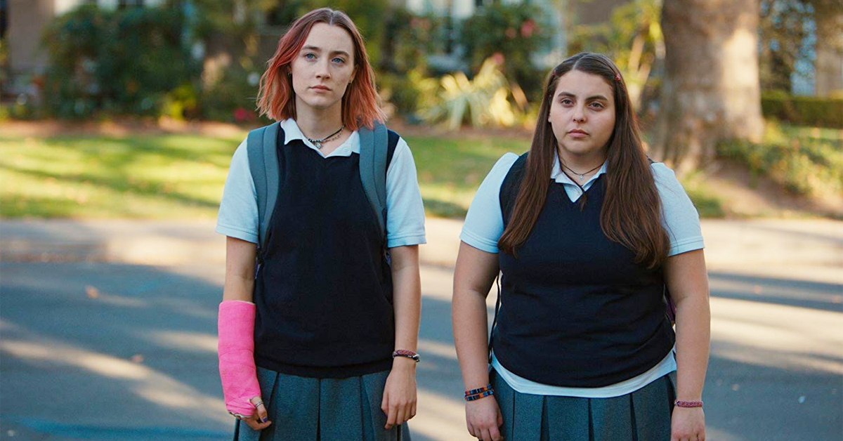 saoirse ronan and beanie feldstein standing on the street in lady bird