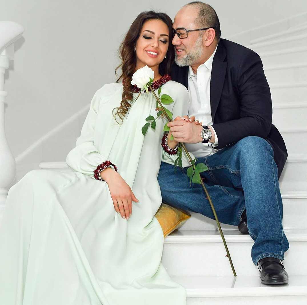 rihana and mohamad with a white rose