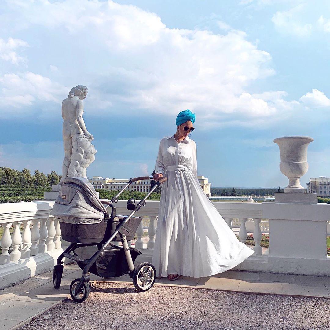 rihana with baby carriage in malaysia