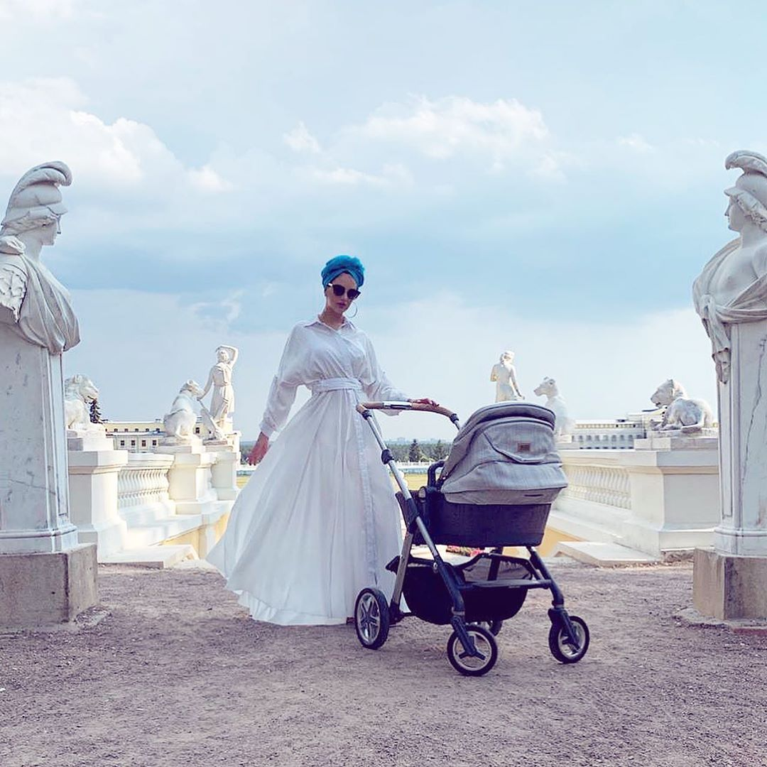 rihana petra with stroller wearing a turban outside