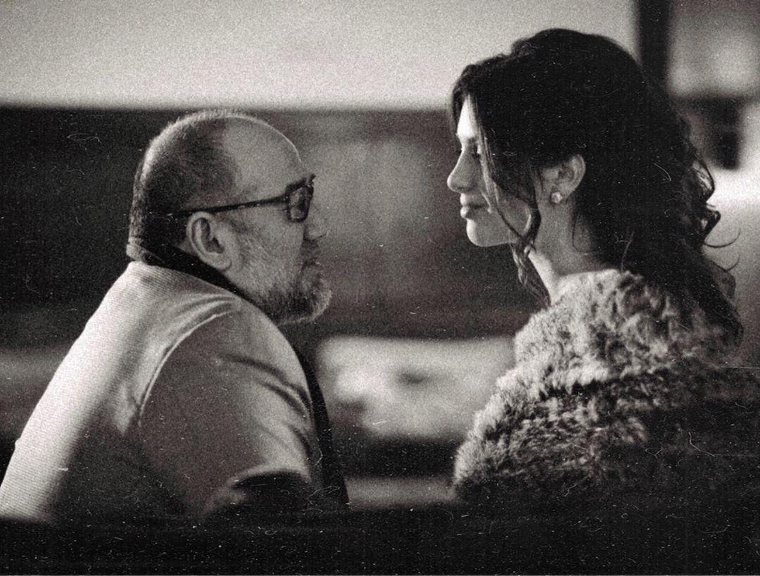 rihana and husband sitting down black and white