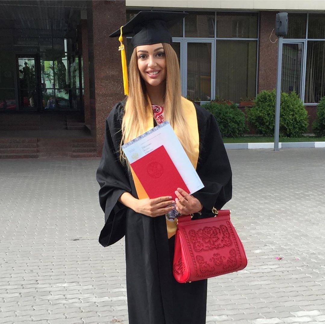 oksana graduates with bachelor's degree