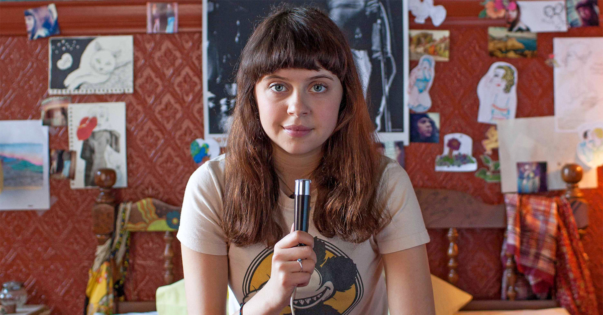 bel powley holding a microphone in the diary of a teenage girl