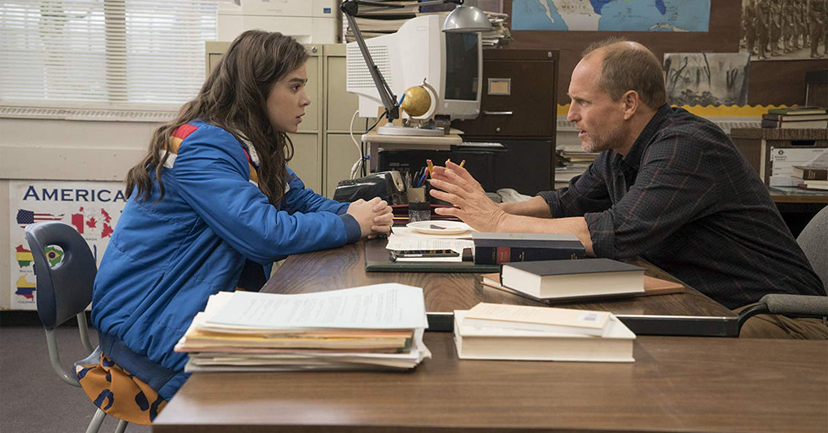 hailee steinfeld and woody harrelson speaking across a desk in the edge of seventeen