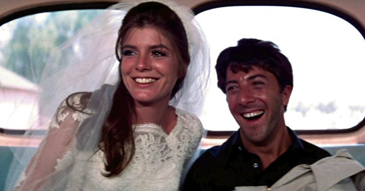 katharine ross and dustin hoffman sitting in the back of the bus in the graduate