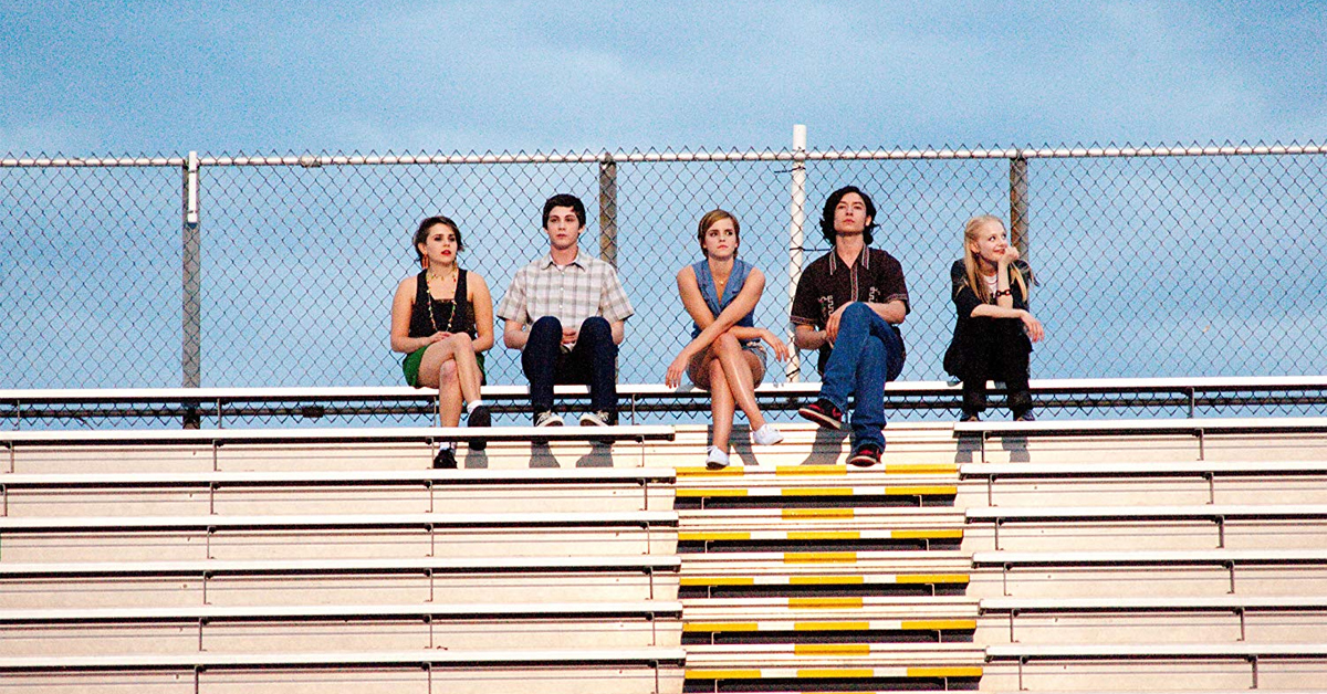 mae whitman, logan lerman, emma watson, ezra miller, and erin wilhelmi sitting on the bleachers in the perks of being a wallflower