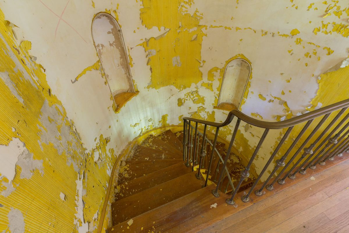 top of yellow staircase circus house abandoned house story