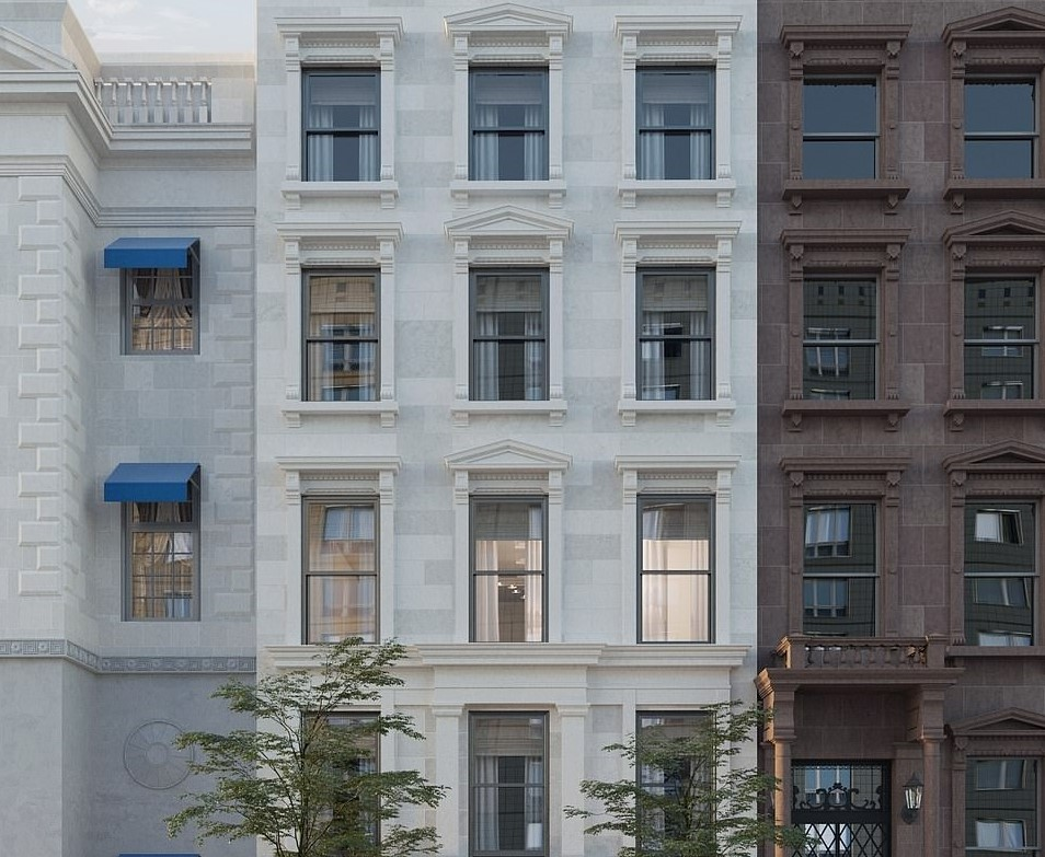 The white mansion boasts four rows of three large, rectangular windows apparent from the street view.