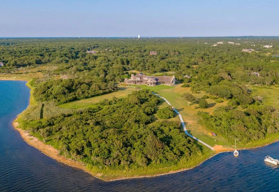 Far away aerial view of the Edgartown estate home and Edgartown Great Pond