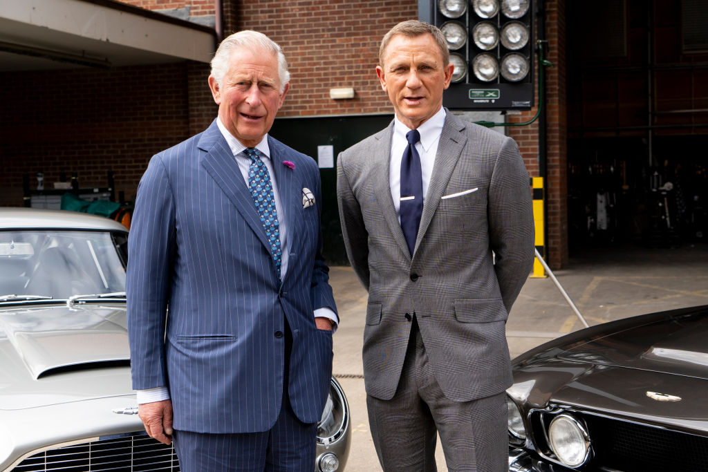 Prince Charles, Prince of Wales poses with British actor Daniel Craig as he tours the set of the 25th James Bond Film at Pinewood Studios