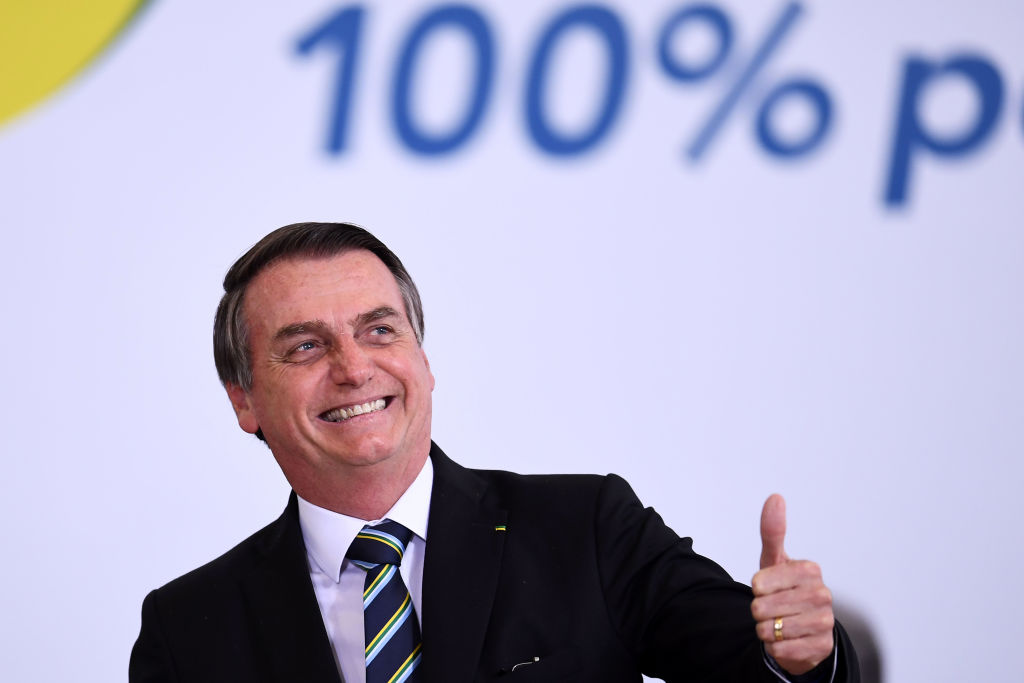Jair Bolsonaro smiles to his audience at an event.