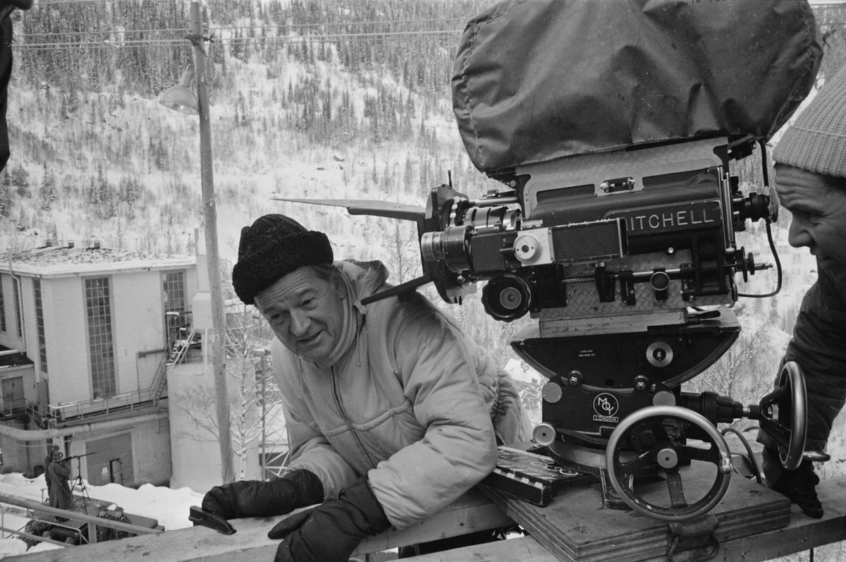 American actor and film director Anthony Mann (1906 - 1967) and a camera operator on the set of war film 'The Heroes of Telemark', Norway, 20th January 1965.
