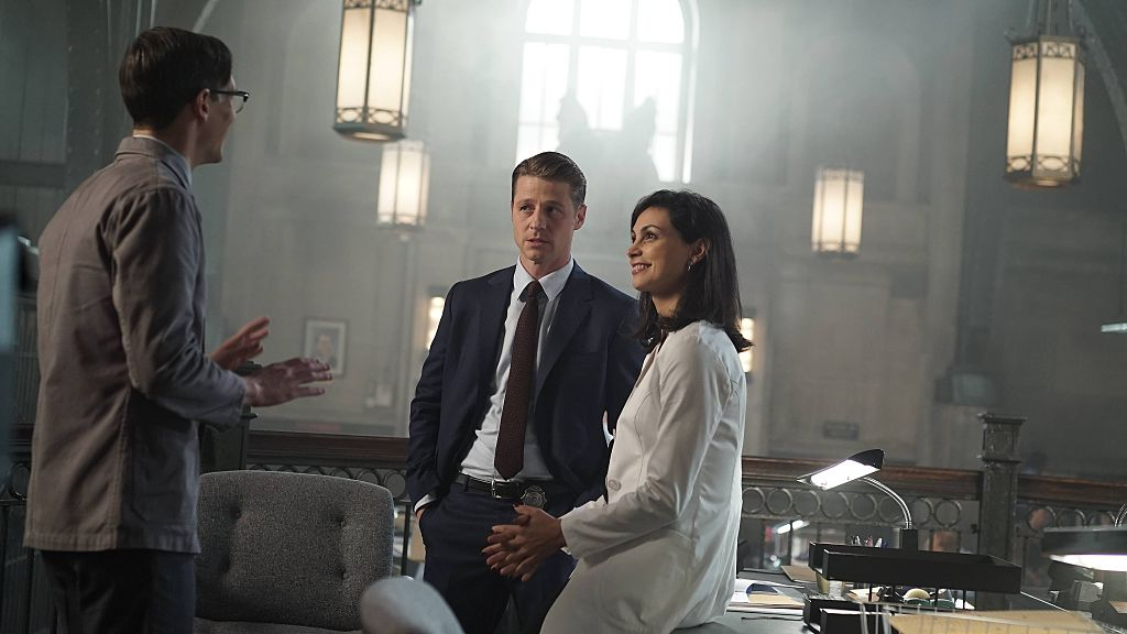 Ben Ben Mckenzie and Morena Baccarin are mid-scene in a still image from their show Gotham.