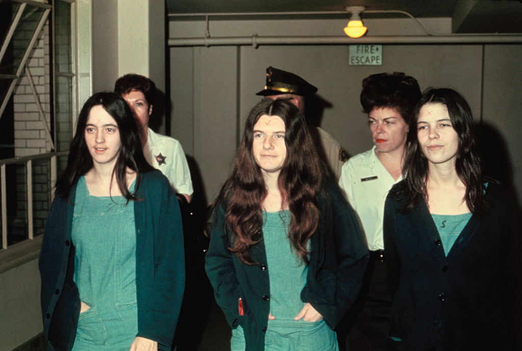 Manson family members and murder suspects Susan Atkins, Patricia Krenwinkle, and Leslie van Houton.