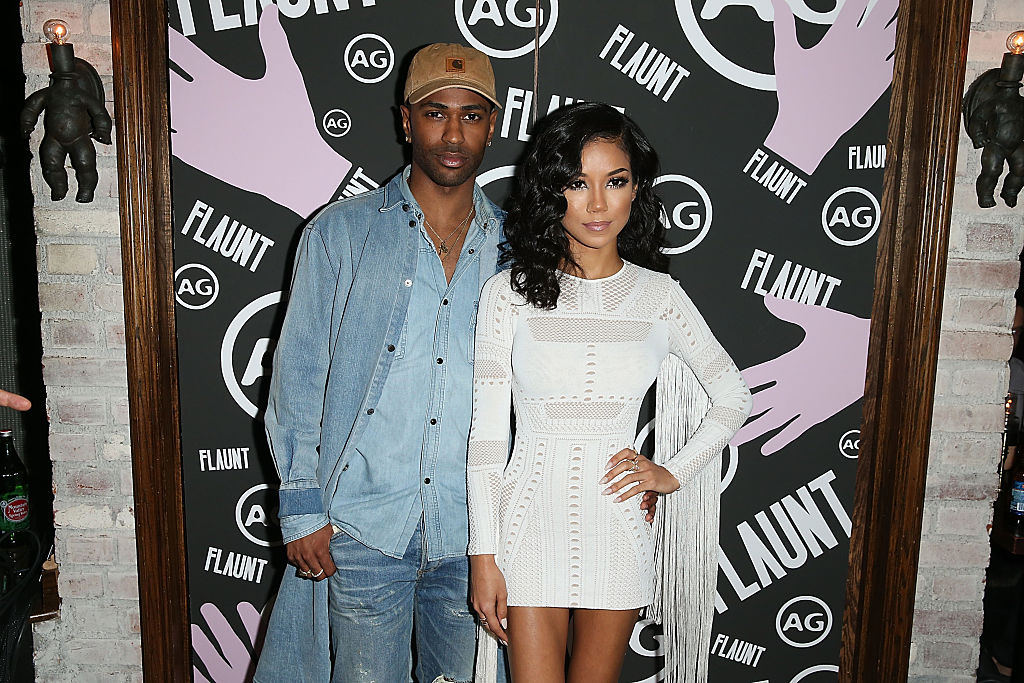 Big Sean And Jhene Aiko are photographed with straight faces at an event.