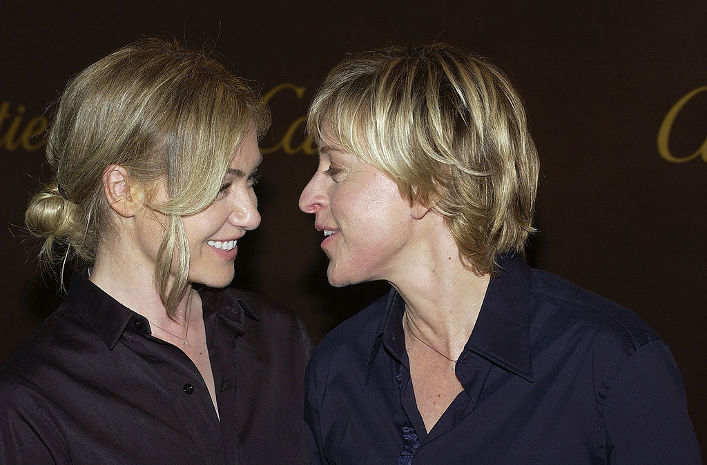 Portia de Rossi and Ellen DeGeneres look lovingly at one another while at an event in Beverly Hills