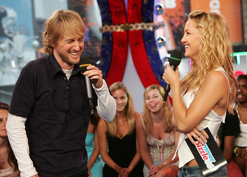 Kate Hudson and Owen Wilson share a laugh while they host on MTV.
