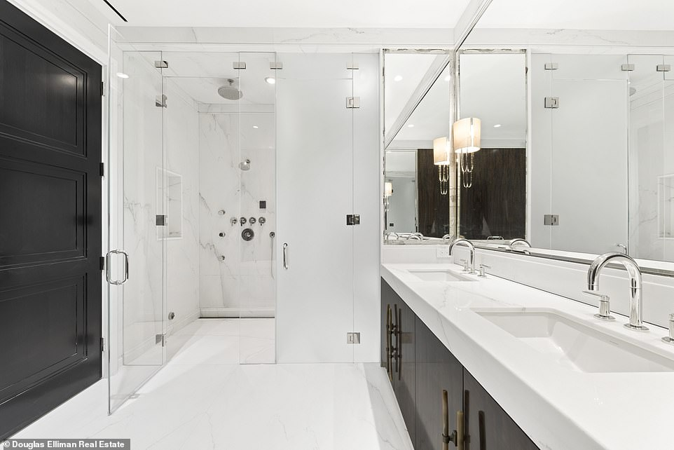 The largest bathroom pictured, double sinks lead towards a separate shower space that doubles the bathroom's size.