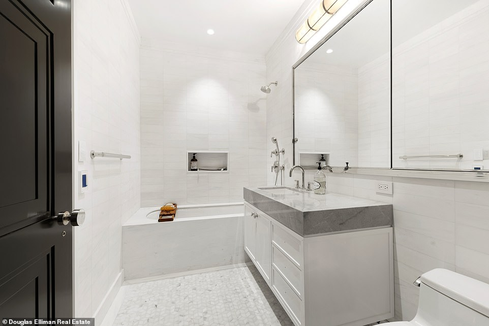 A relatively modest bathroom is equipped with a single sink, toilet, tub and shower.