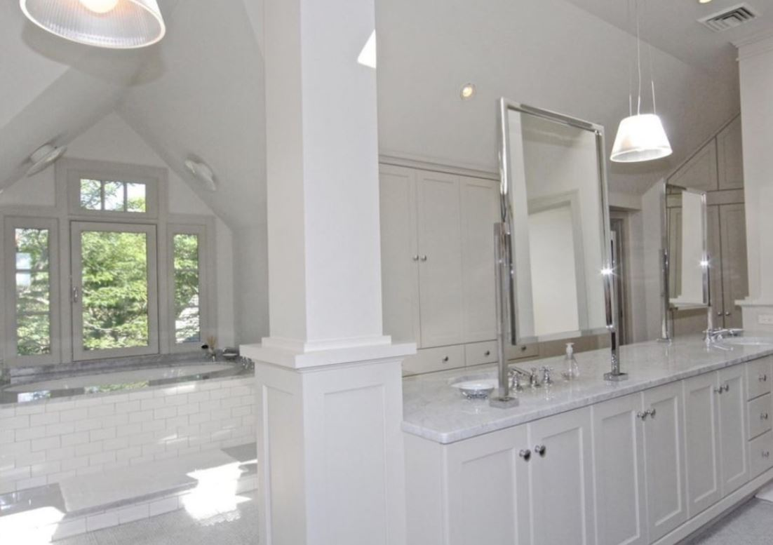 One of the estate's nine bathrooms, with counters on the right and a bathtub on the left