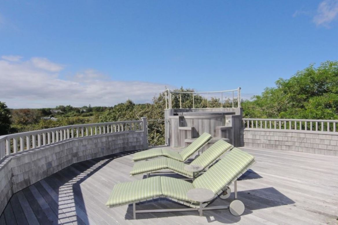 A second-story deck in the Edgartown estate with a built-in jacuzzi
